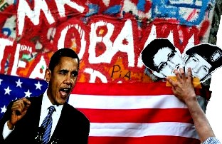 Activists display a photo of US President Barack Obama (L) and pictures of former US spy Edward Snowden (C) and whistleblower Bradley Manning (R) during a protest action on June 19, 2013 in Berlin on behalf of the visit of the US President in the German capital. Barack Obama will walk in John F. Kennedy's footsteps this week on his first visit to Berlin as US president, but encounter a more powerful and sceptical Germany in talks on trade and secret surveillance practices.. AFP PHOTO / RONNY HARTMANN