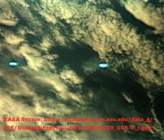 NASA recunoaşte, fără să vrea, existenţa navelor spaţiale extraterestre! O fotografie cu OZN-uri luminoase dă de gol agenţia spaţială americană...