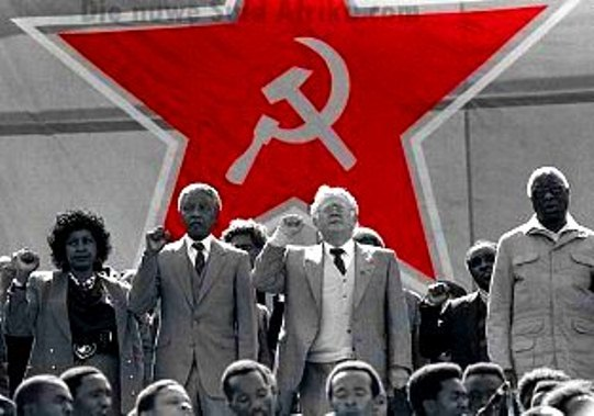 No. 62  Winnie Mandela, Nelson Mandela and Joe Slovo at a SACP rally, FNB  Stadium, July 1990.